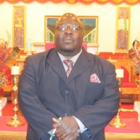 Minister Vincent Lester